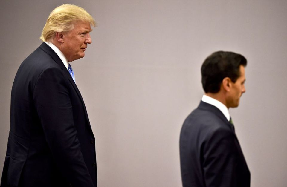 Mexican President Enrique Pena Nieto (R) is followed by US presidential candidate Donald Trump after a meeting in Mexico City on August 31, 2016. Donald Trump was expected in Mexico Wednesday to meet its president, in a move aimed at showing that despite the Republican White House hopeful's hardline opposition to illegal immigration he is no close-minded xenophobe. Trump stunned the political establishment when he announced late Tuesday that he was making the surprise trip south of the border to meet with President Enrique Pena Nieto, a sharp Trump critic.  / AFP / YURI CORTEZ        (Photo credit should read YURI CORTEZ/AFP/Getty Images)